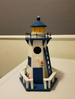 Celebrate Spring Together Lighthouse Birdhouse. Attached Rop